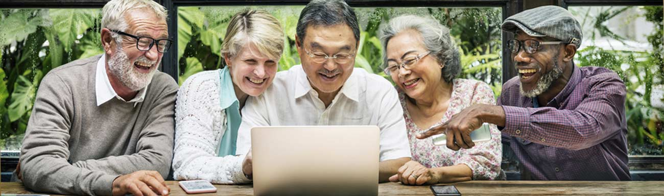 Dementia Caregivers share a laptop for Online dementia caregiver training.
