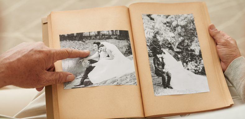 Senior couple looking at their wedding photos in photo album